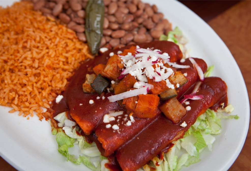 Enchiladas de la Plaza have the filling and sauce atop the tortillas