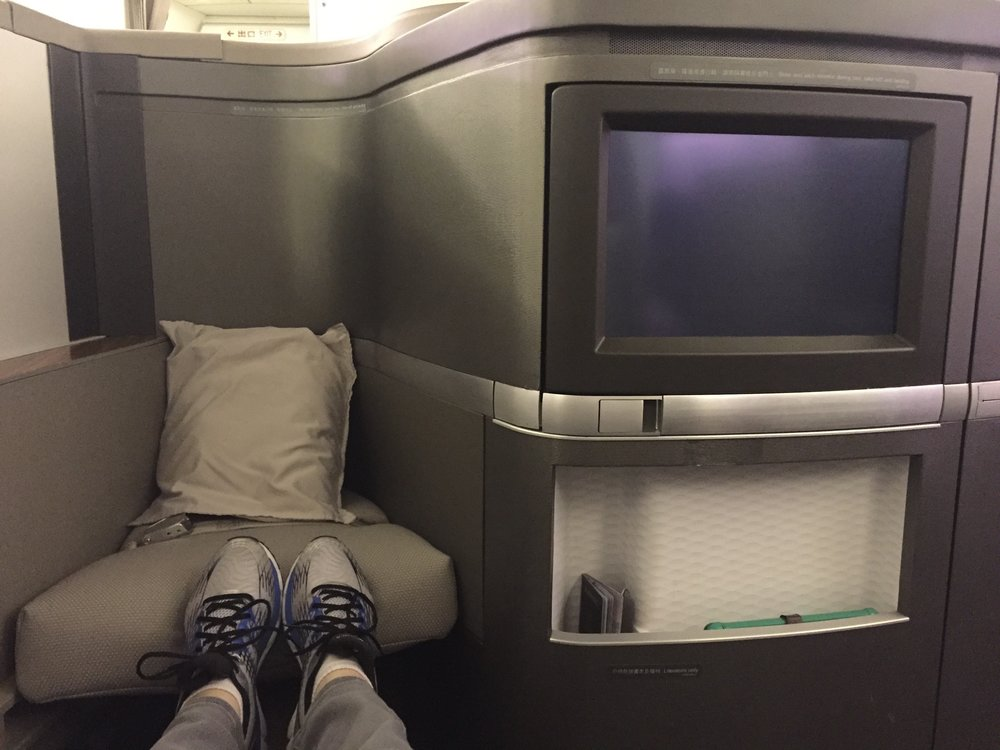 Cathay Pacific first class IFE, storage, and buddy seat / footrest