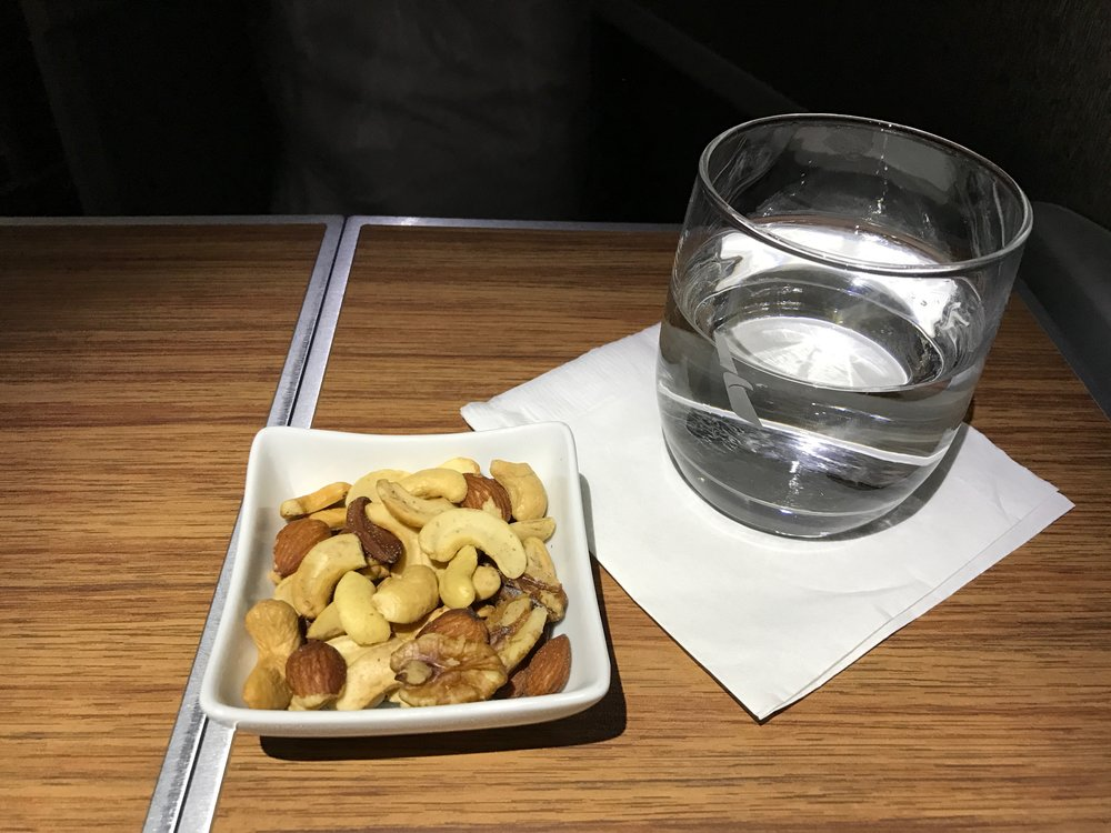 AA 787 Dreamliner Business Class drink and warm nuts