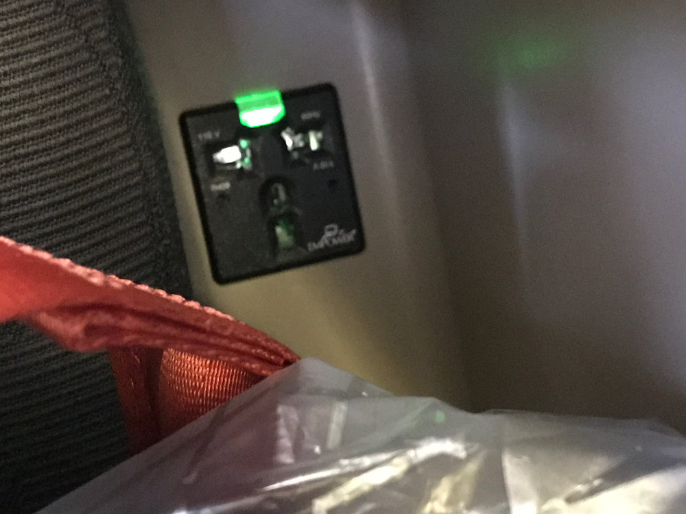 Turkish Airlines business class seat power outlet.jpg