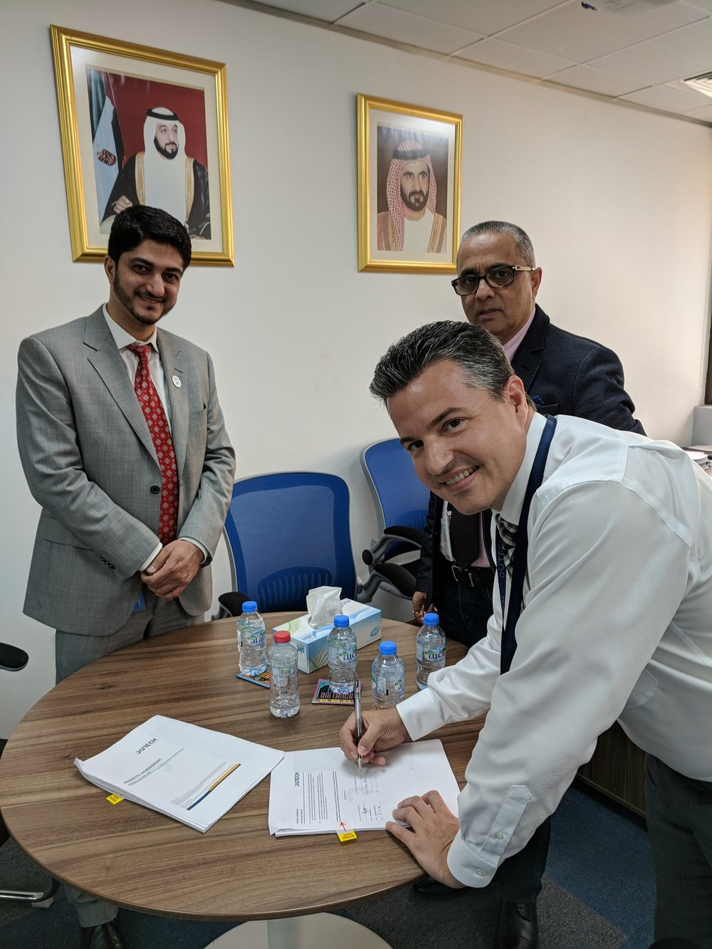 TTEK CPO, Dan Rochon signs contract with Dutech representatives Farruq Ahmed and Ayaz Maqbool