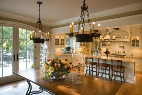 Warm, layered light in a traditional kitchen and dining room.