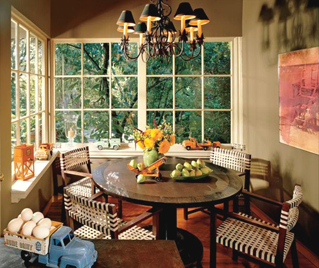 Traditional breakfast nook with shaded wrought iron chandelier.