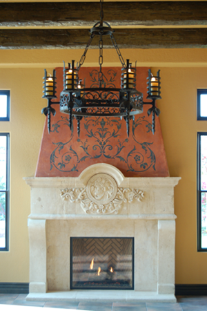 Lancelot Chandelier against a Tuscan style fireplace.