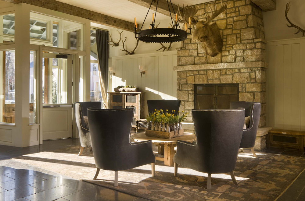A rustic lodge with Laura Lee Designs Harvard Chandelier.