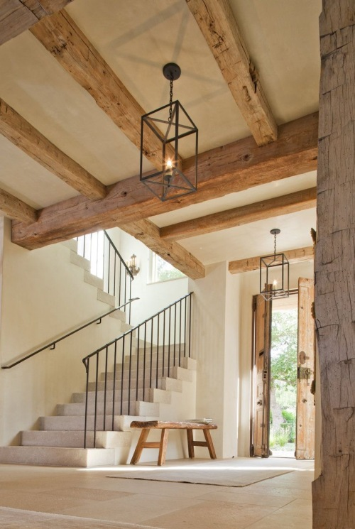 Elegant, rustic wrought iron pendants for a farmhouse style entryway.