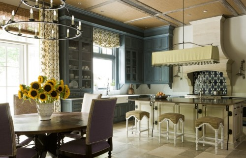 A custom Toscana Chandelier in a French Provencal style kitchen.