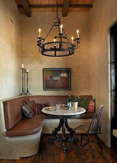 Dining nook with a custom wrought iron Julien Chandelier.