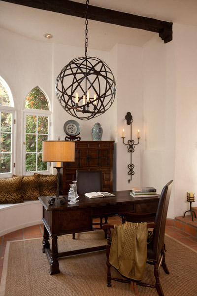 A Spanish-style Los Angeles home with a Mars Chandelier and Jasmine Sconce.