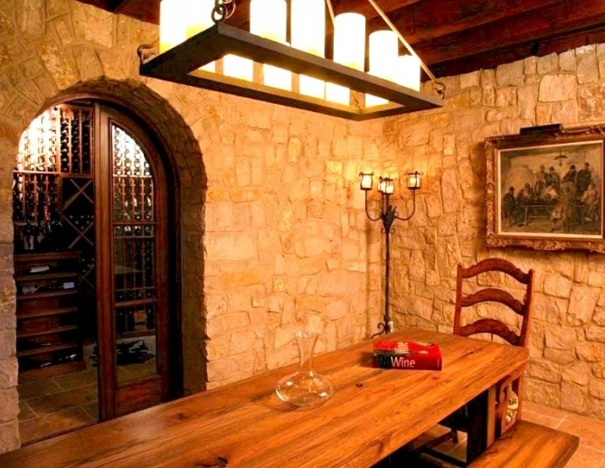 Custom wrought iron Mallorca Chandelier in a rustic stone wine cellar.