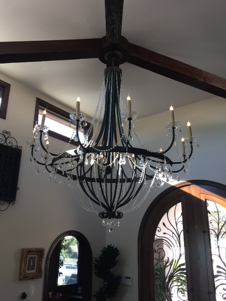 A custom crystal accented Monaco Chandelier.