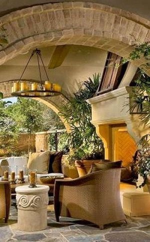 Tuscan style outdoor living room with a Mallorca Chandelier.