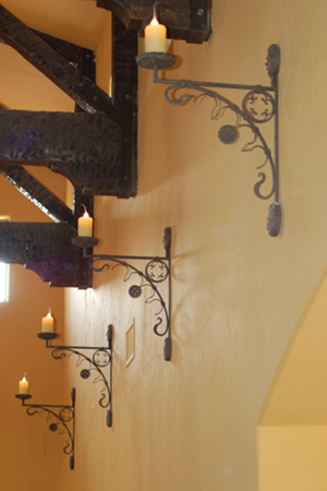 Old world Spanish style wrought iron sconces.