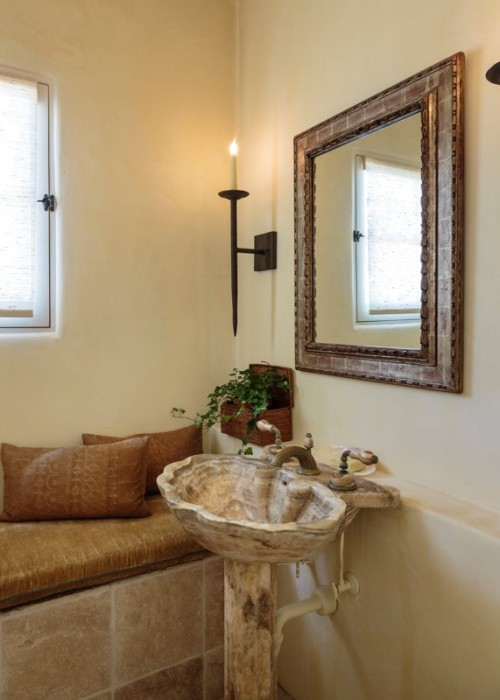 Mediterranean style bathroom with Naxos Sconces.