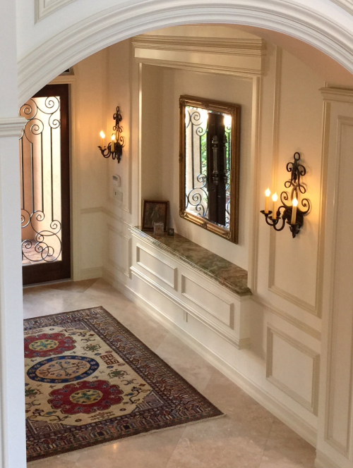 Laura Lee Designs sconces in a traditional entryway.