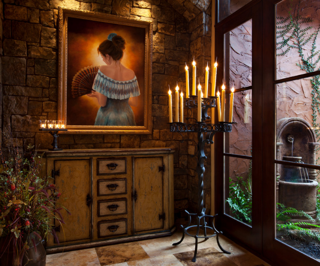 Hacienda style interior with a Laura Lee Designs custom candelabra.