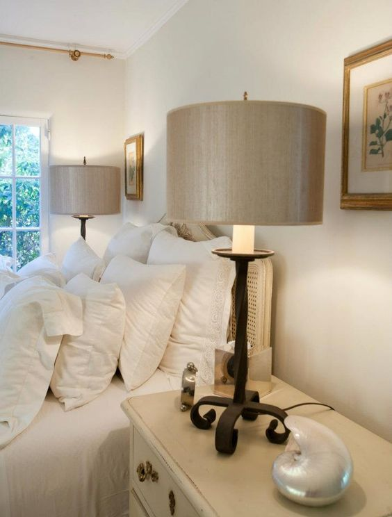 Bedside table lamps in a beach inspired bedroom.