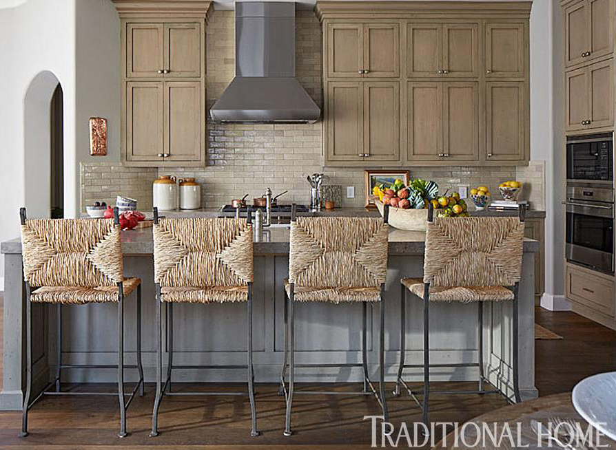 Laura Lee Designs rush bar stools in Traditional Home Magazine.