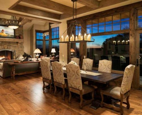 Single Tier Mallorca Chandelier with down lights installed in the dining area.