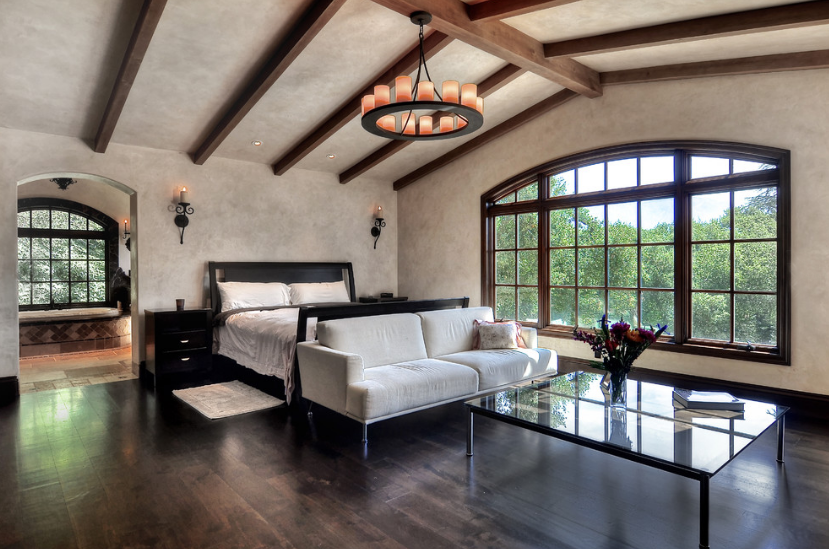 The Single Tier Mallorca Chandelier and Adonis Sconces in the master bedroom.