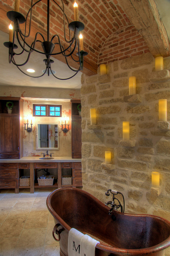 A custom Bell Chandelier with Laura Lee Designs sconces in the master bath.