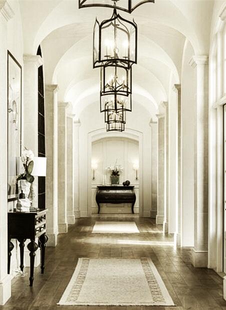 Urbino Lanterns in a bright, airy foyer.