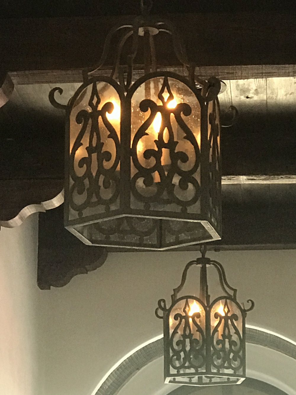 Custom entryway lanterns in a Spanish style home.