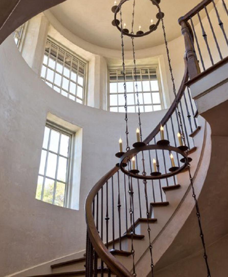A custom Toscana Chandelier spanning a 2 story vestibule.