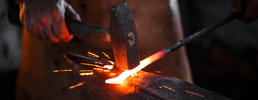 blacksmith forging wrought iron.jpg