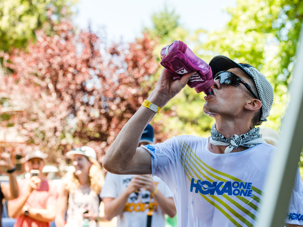 Jim Walmsley_aid station_drinking water_Western States_Ryland West.jpg