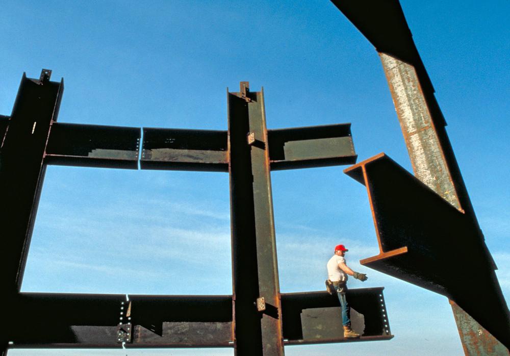 iron worker near top of International Place