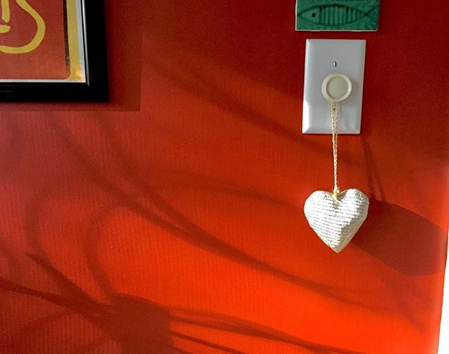 Early morning light on our kitchen wall. #red, #white #heart #wall #lightswitch