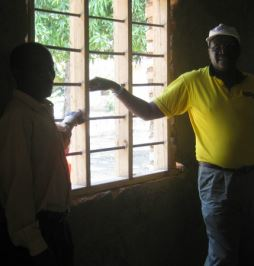 The Pastor of the church showing the newly installed windows!