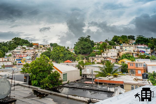 Welcome to the pueblo, where the streets are always calling and someone out there wants to know your name.  Come play. #adventure #citylife #pueblolife #rincon #rinconpr #vacationpr #vacationpuertorico #787 #citystreets #rooftops #rooftop #hills #colorfulhouses #housesonahill #tropical #puertorico #vivapuertorico #travel #wanderlust #citycenter #love #play #comeplay #getlost #notallthosewhowanderarelost #quecheverepr