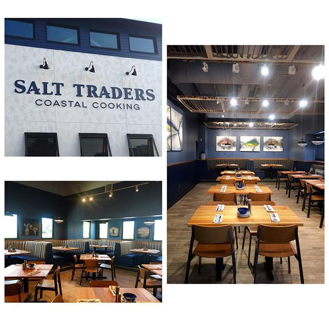 Salt Traders Coastal Cooking is now open! This space includes a patio, bar seating, and tables that are inspired by its coastal influences with reclaimed wood and thematic artwork. A fun and unique project that Pinnacle is proud to have been a part of! #buildingupaustin #generalcontractor #pinnacleconstruction #salttraders #nowopen