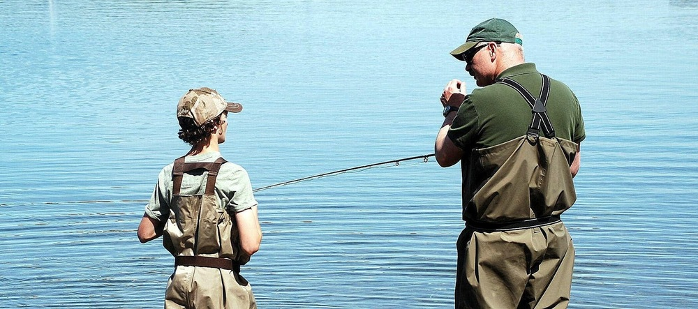 Shawn Willard Brown teaching Cole the fine art of a single hand fly rod.
