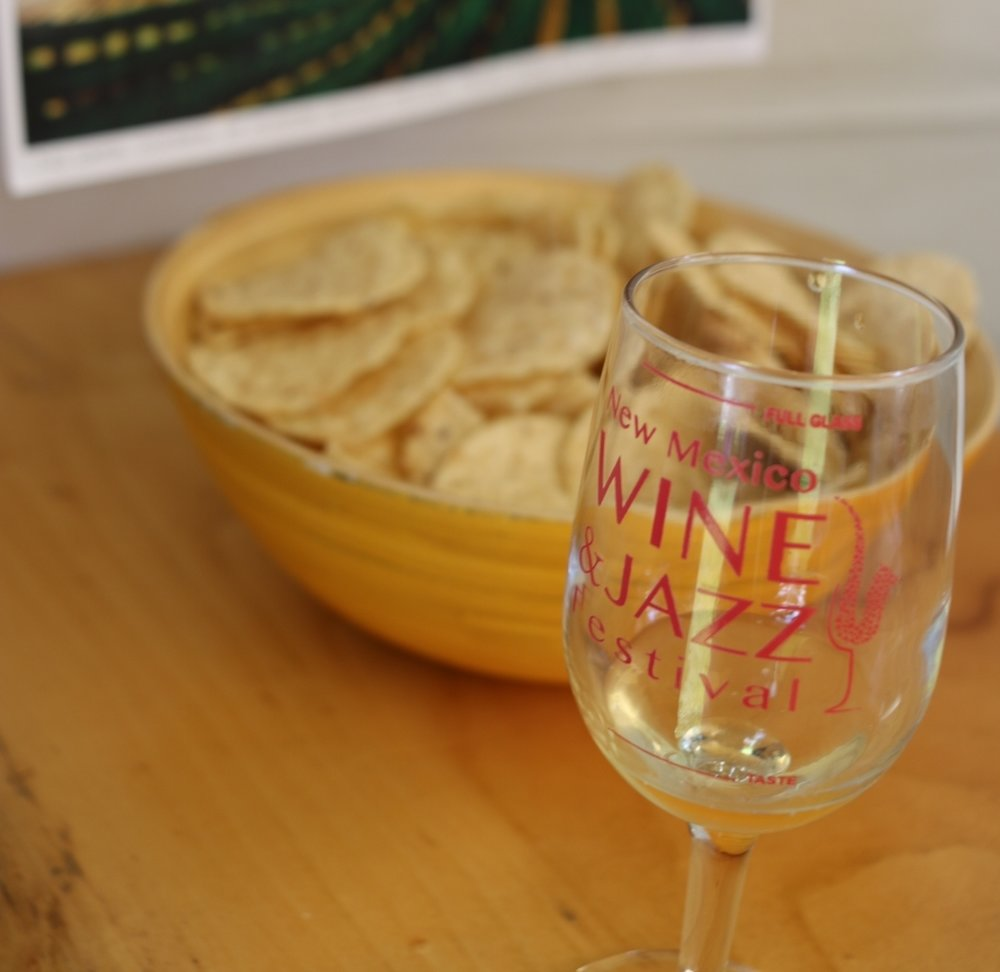 At a NM wine tasting you may find tortilla chips instead of bread and cheese. I ain't complainin'.