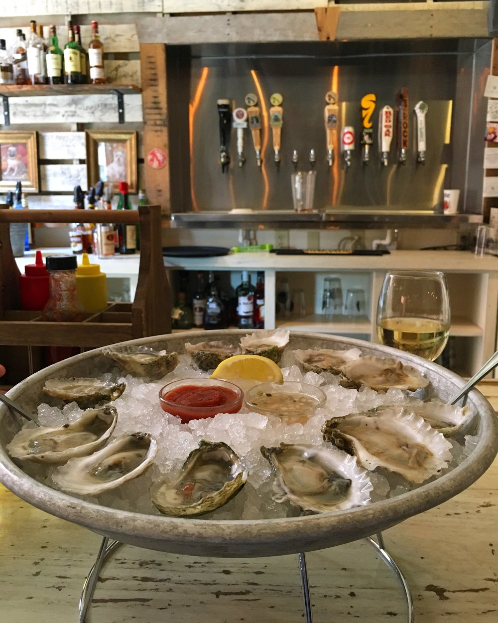 A dozen Harker's Island oysters is a fitting way to start lunch at The Boiler Room!