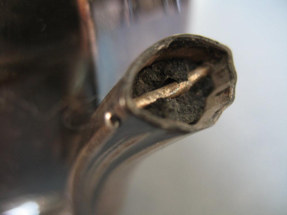 Close-up view of broken insulator and rivet