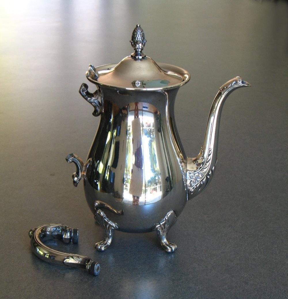 Broken insulators on a silverplate coffeepot