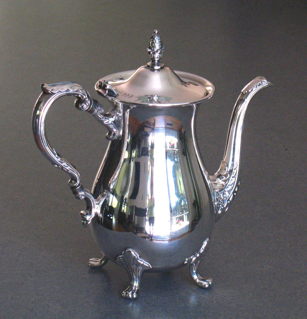 Silverplate coffeepot insulator repaired