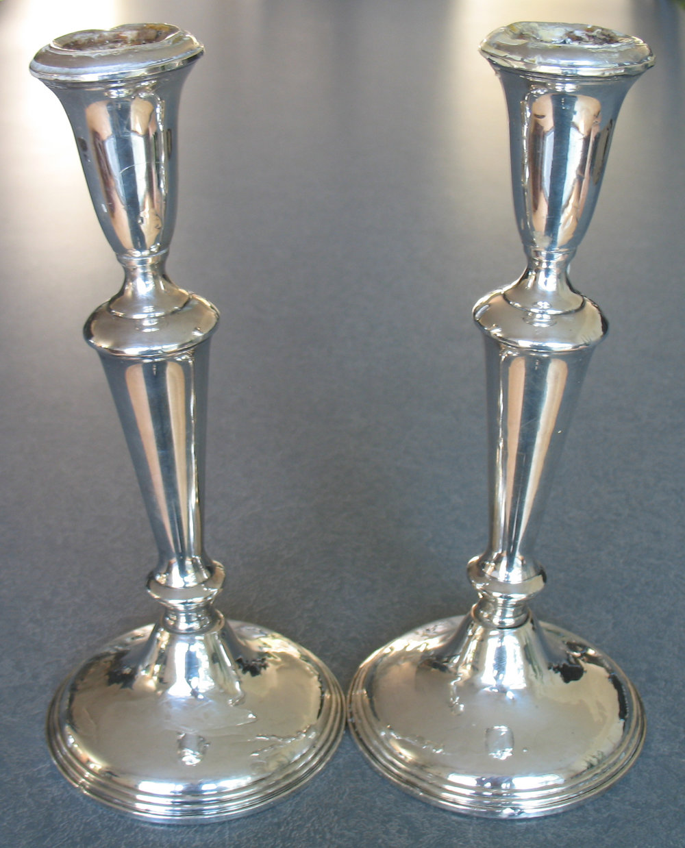 Sterling-silver-candlesticks-leaning-over-before-repair.jpg