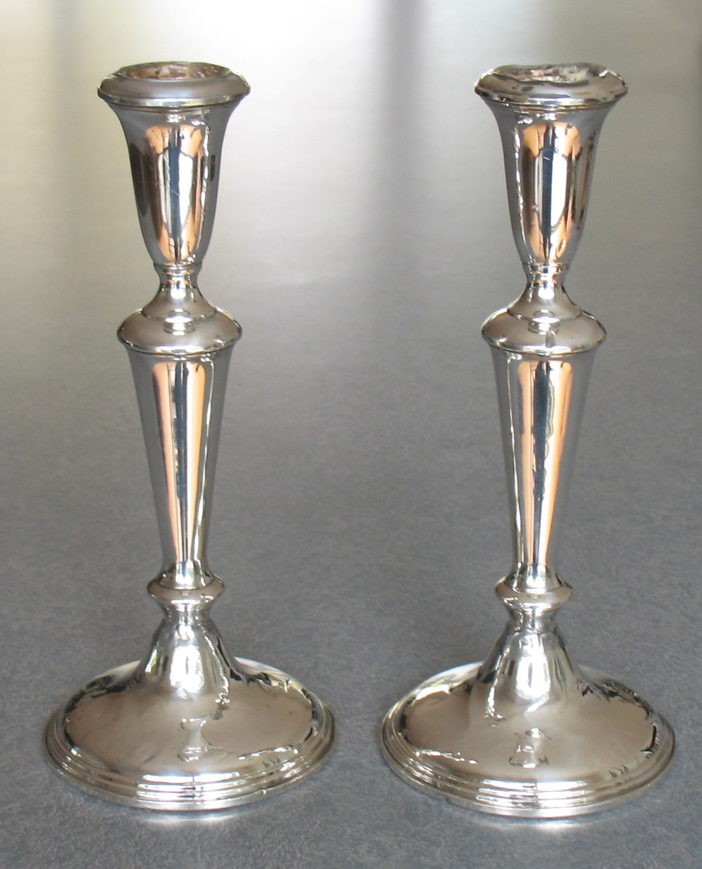 straightened silver candlesticks