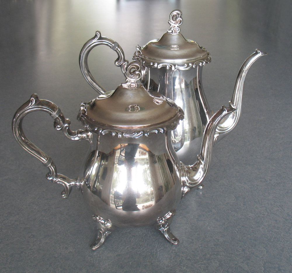 Silverplate teapot and coffeepot with the hinge repaired
