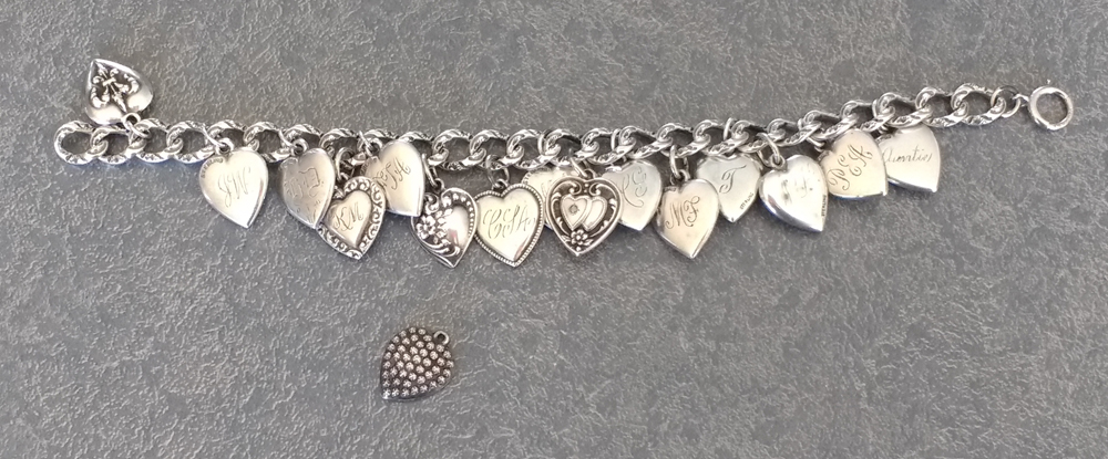 Sterling silver jewelry vintage charm bracelet with charm to add.