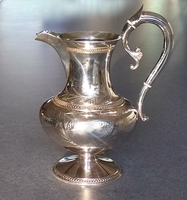 Sterling silver coffeepot had dents removed and the handle repaired.