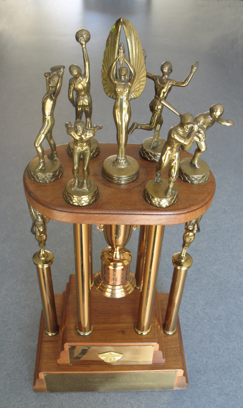 Athletic trophy with athletic figures broken is now repaired.