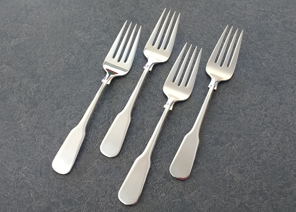 sterling silver forks with the fork tines even and polished