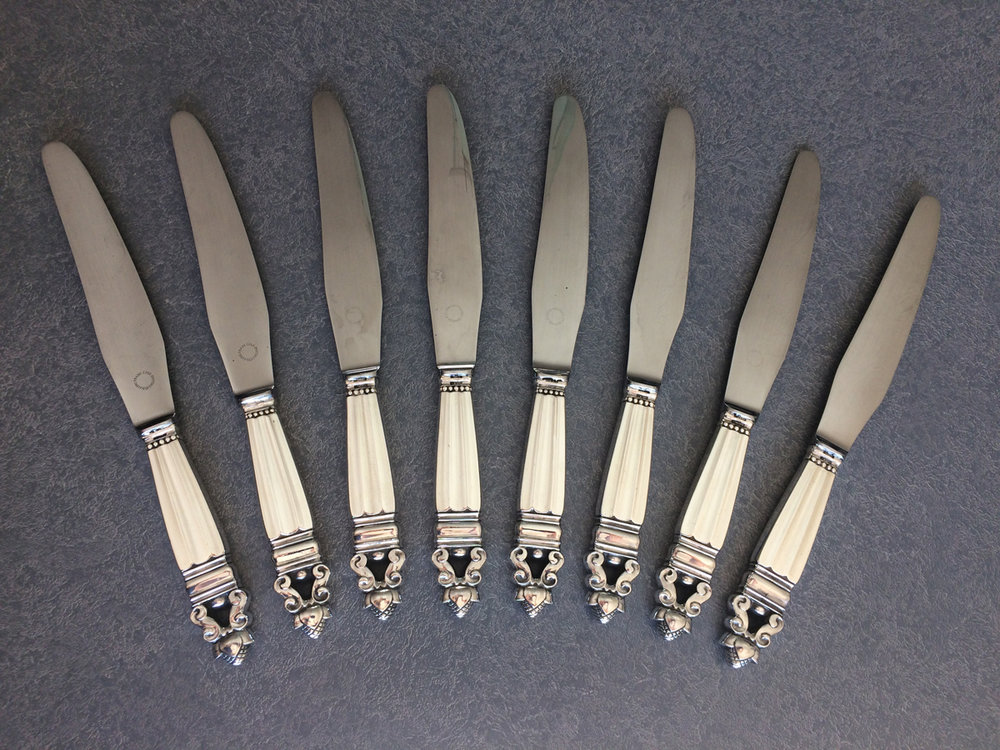 sterling silver handled knives with the blades reset in the handles
