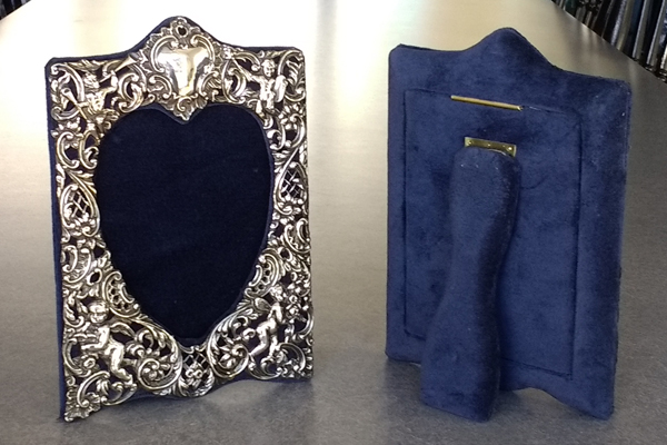 Sterling picture frame with front and back view